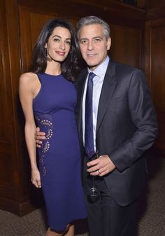 With George Clooney at the 100 LIVES Event. See all of Amal's best looks.