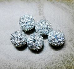 5pcs of 10mm silver tone disco balls, CZ crystal beads spacer findings, clear cz crystal. $8.19, via Etsy.