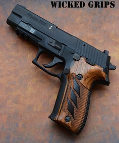 SIG P226 With Oak and Ebony inlay custom grips.