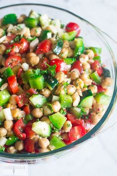 5 Minute Chopped Chickpea Salad I love this simple Chopped Chickpea Salad. It requires very little prep time and is super healthy! 5 Minute Chopped Chickpea Salad You'll need: two 16 ounce cans of chickpeas, drained 1 medium cucumb Easy Salad Recipes, Easy Salads, Healthy Salads, Summer Salads, Vegetarian Recipes, Healthy Eating, Cooking Recipes, Healthy Recipes, Chickpea Salad Recipes