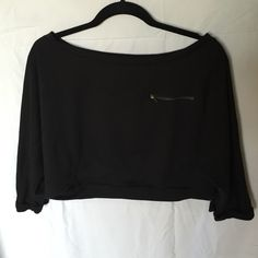 Monteau cropped tee shirt This tee shirt is cropped with a zipper on the upper left chest. It is in great condition Monteau Tops Crop Tops