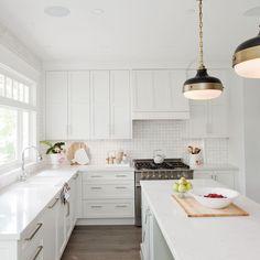 Love It Or List It Vancouver: Christine & Chris. Crisp white kitchen.
