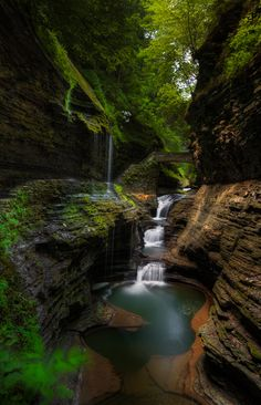 Rainbow Bridge and Falls inside Watkin's Glen State Park - New York by Chris Harnish