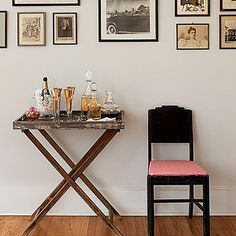 Set up a Self-Serve Bar | Positioned under an arrangement of family photos, a freestanding Champagne-and-cocktails bar is easily accessible and makes a fun gathering spot for generational reminiscing.