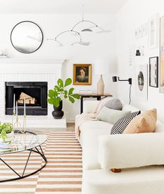 West Elm accents like the asymmetrical lamp and rattan candle holder help tie this clay-colored living room together.