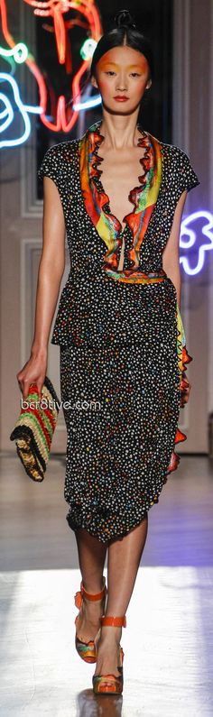 playful design - every colour is dotted in this black dress and it's lovely ruffled neckline collar. Tsumori Chisato Spring Summer 2013