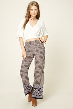 $8 A pair of woven palazzo pants featuring an allover ornate print, straight leg, and a smocked waist.