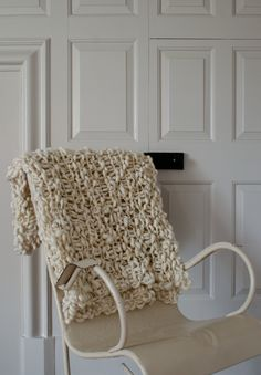 "DIY: A Chunky Blanket ~ ""This is a where-did-you-get-this?! kind of blanket. It's that time of year when warm, cozy blankets are on my mind, so I thought I would bring you another easy and beautiful knit to try. This is made with knit and purl stitches alone and should knit up in a flash."" from The Purl Bee {check comments section for more affordable yarn suggestion}"