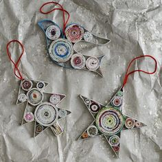 Coiled paper ornaments.  To coil paper, you cut strips, mod podge, fold edges of strip to the center and fold again.  Could make these as thick as you want.  I would like to try dyed newsprint to obtain the colors I want.