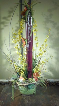 This design with bamboo and oncidium orchids was created as a sympathy gift.  It's artful value can be enjoyed by the recipients for years.  Joe Guggia AIFD