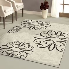 Better Homes and Gardens Iron Fleur Area Rug multiple sizes from ~$13-$170; comes in cream/chocolate, black/white, beige, and chocolate; @walmart.com