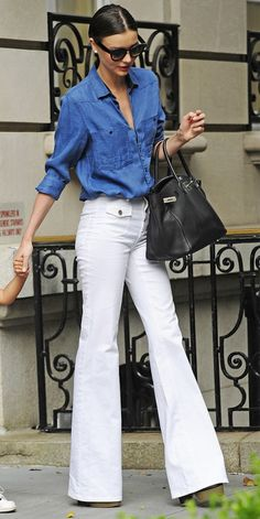Miranda Kerr styling double denim with a twist - white flared jeans and a classic denim shirt. #denim #celebrity #streetstyle #style #fashion