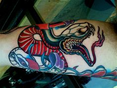 Amazing snake tattoo! Lots of bright vibrant colors, the finished product is outstanding!