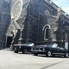 Mustangs in Black 1967 GT Convertible and 1966 Shelby GT350 Convertible Ford Mustangs at St Peter and St Paul church in Melbourne for James and Natasha's wedding.