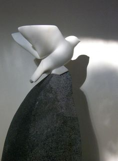Carrara marble. granite Birds Sculptures or statue by artist Peter Graham titled: '`Carrara Finch` (Carved marble Taking Off statuette statue)'