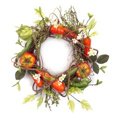 Add a fun touch to your spring or summer decor with this unique wreath. Perfect to hang on your door or wall, this wreath features a variety of faux garden vegetables.