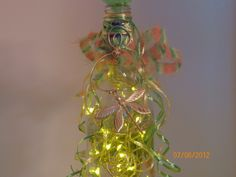 Zoom shot of back bottle jewelry on dragonfly bottle...again this was my design inspiration...will be doing a motorycle themed light next...and on to another new venture with glass bottles, cut glass designs like wind chimes, candle holders, and decoupaging bottles, possibly with cutouts so lights will show through, or just make vases or dishes out of