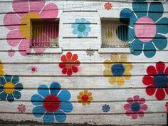 Flowery painted building walls make me very happy.