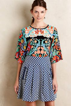 Love the color and pattern.  Could wear to work tucked into a skirt or out over jeans