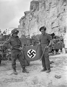 Two Cameron Highlanders of Ottawa, flaunting a captured German flag at Hautmesnil, France, (LAC, Canadian Soldiers, Canadian Army, British Army, Army Love, Us Army, Scottish Army, Ww2 Veterans, D Day, World War Two