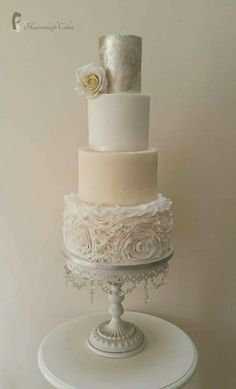 vintage, ruffle rossette cake with silver leaf