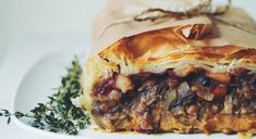 This plant-based roast has layers of savory mushroom lentil stew, mashed sweet potato, and an apple cranberry sauce all wrapped up into a puff pastry package. Cooking Sweet Potatoes, Mashed Sweet Potatoes, Strudel, Vegan Thanksgiving, Vegan Christmas, Christmas Roast, Thanksgiving Leftovers, Thanksgiving Games, Lentil Stew