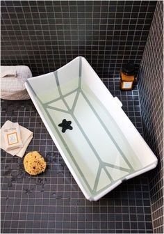 Uniquely foldable Stokke Flexi Bath. The perfect solution for bathing baby in a shower stall!