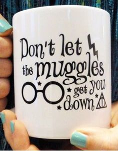 Harry Potter mug reads...Don't let the muggles get you down. From Etsy.
