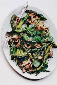 Roasted asparagus and hen-of-the-woods mushrooms go with any Easter dish, from glazed ham to a spring quiche. The vegetables roast first in olive oil then finish in butter for an extra dimension of flavor and a nice sheen. A drizzle of syrupy aged balsamic balances the earthiness of the mushrooms and slight char on the asparagus.#asparagus #asparagusrecipes Asparagus And Mushrooms, Asparagus Recipe, Stuffed Mushrooms, Sauce Recipes, Wine Recipes, Easter Dishes, Pasta Sides, Prop Styling, Easter Brunch