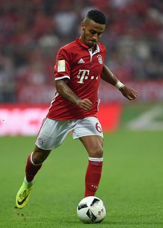 Bayern Munich's Spanish midfielder Thiago Alcantara plays the ball during the German first division Bundesliga football match between FC Bayern...