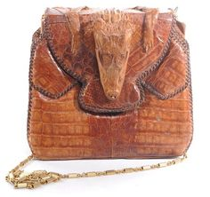 Vintage Crocodile Bag with Head- Reworked with a Chain Strap- 1 available here: http://www.thevintagetwin.com/shop/products.cgi?sku=5379&sex=f
