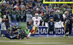 San Francisco 49ers quarterback Colin Kaepernick #7 runs for a 58-yard run against the defense of the Seattle Seahawks during the NFC Championship NFL football game at CenturyLink Field on Sunday, Jan. 19, 2014, in Seattle. (Perry Knotts/NFL)