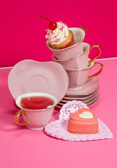 Dream and Sugar Tea Set in Petal - Thank your friends for being so lovely by gathering them around this adorable teacup set for a gourmet fete! Garnished with golden trim and matching handles, this boxed set features six heart-shaped mugs and matching saucers in a superbly posh pink hue.