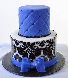 Pastry Palace Las Vegas Birthday Cake 1324 - Damask & Blue. This two-tiered design in black, white, and blue is one for any occasion. The intricate classic damask motif is expertly executed in satin black against the dazzling white background of the lower tier. The upper tier is iced in a stunning periwinkle blue, and the quilting effect adds depth and texture to the overall impact.