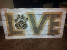 <3 Love sign with a paw print. Cute for all dog lovers!!!  Donated by Reuse it Art to raffle for 100+ Abandoned dogs of Everglades Florida