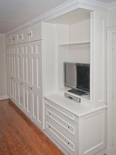 Built-in bedroom closet and entertainment unit.