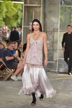 Kendall Jenner Stuns In Fringe Frock On The Givenchy Runway. It is no surprise that Kendall Jenner is BFF with Riccardo Tisci, so obviously she was hand picked to walk the runway for the Spring/Summer 2016 Givenchy Men's Show. Kendall killed it on the catwalk, showing off a glam couture creation.