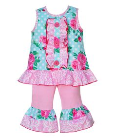 5318f4e09 This adorable girl's two piece set from AnnLoren features a tiffany rose  print tunic embellished by a pink damask trim.Pink jersey cotton capri  pants have ...