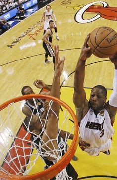 Dwyane Wade dunks against Tim Duncan during the first half of Game 6 in their 2013 NBA Finals basketball series
