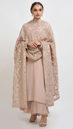 From our Wedding and Bridal Collection, this is an oyster pink pure crepe suit with intricate exquisite silvery gold gota patti and gold dabka work hand embroidery. The gota patti embroidered on the shirt at front-back neckline and sleeve ends. Dress Indian Style, Indian Dresses, Indian Attire, Indian Wear, Pakistani Outfits, Indian Outfits, Indian Designer Suits, Embroidery Suits, Hand Embroidery