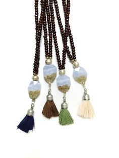 Ohm Olive - luminescent blue agate pendant with olive colored tassel on dark brown beaded cord LAYERING NECKLACE