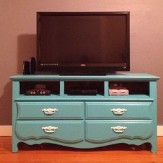 Wish I had a before photo...  My old dresser turned tv stand! Took the top drawers out and my dad put plywood in for shelves. Then we just painted it and the handles! Easy peasy!