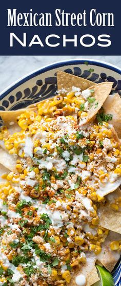 Street Corn Nachos! Tortilla chips topped a creamy monterey jack cheese sauce, toasted corn, crumbled cotija, chili powder and cilantro. Perfect for a game day gathering or fiesta! On SimplyRecipes.com