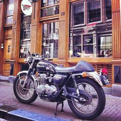 Honda CB500 Cafe Racer in front of the Red Wing Store Amsterdam