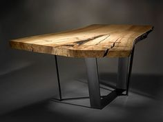 Neiman table by Stacklab (naturally oiled, spalted maple slab paired with a custom steel pedestal base).