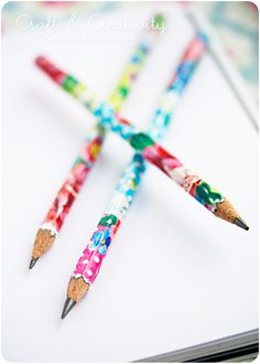 Decopage Pencils - cut a strip of a magazine page or wrapping paper, cover it and the pencil with Modge Podge, and roll the paper around the pencil. Brush on a layer of varnish or use clear acrylic spray. Stand pencils in a glass jar for 2 hours. When completely dry, sharpen to remove the excess paper. To create a pencil bouquet, tape an artificial flower to the eraser end of each pencil.