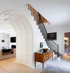 Paneled arch, stairway | Anne Decker Architects