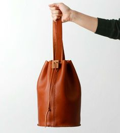 Leather Drawstring Bag | I adore the wood block detail and you can't beat that rich camel tone.
