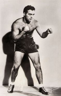 https://flic.kr/p/SwxdMB | Marcel Cerdan | French postcard by Edition O.P., Paris, no. 23. Photo: Studio Harcourt.  World boxing champion Marcel Cerdan (1916-1949) was France's greatest boxer with the nickname 'The Casablanca Clouter'. His life was marked by his sporting achievements, his passionate love affair with Édith Piaf and his tragical death. He appeared in two films and was portrayed in two films.  For more postcards, a bio and clips check out our blog European Film Star Postcards…