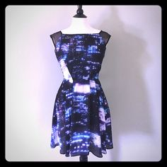 """Milly New York Cityscapes Dress Size 6 Gorgeous Milly New York dress in a Size 6.✨ Vibrant bluesand purplesenhance an abstract nighttime cityscape all aglow. Pleated skirt for a fit & flare silhouette. Black sheer cap sleeves and shiny silver back zipper. Fully lined. Only worn twice, like new condition!Laying flat: Chest 17.5""""  Waist 14.5""""  Length 30"""".I consider reasonable offers! Milly Dresses"""
